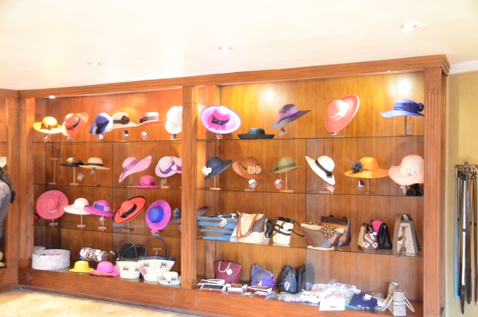 Women's hats and purses on display in showroom