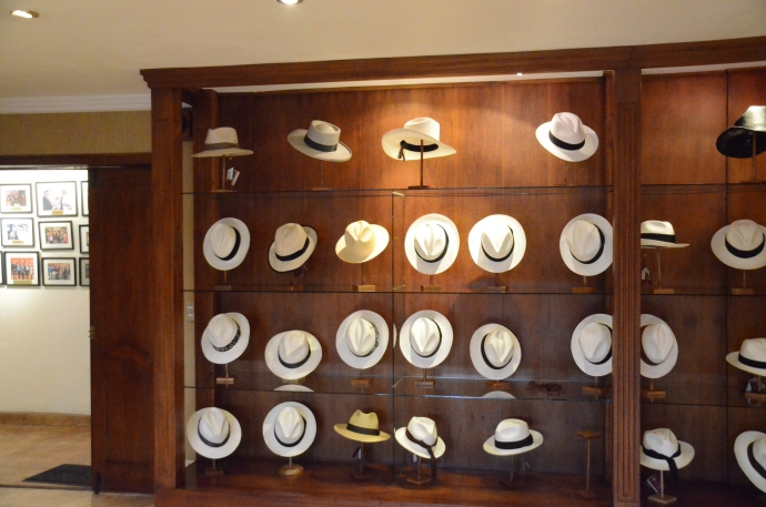 Men's hats on display in showroom