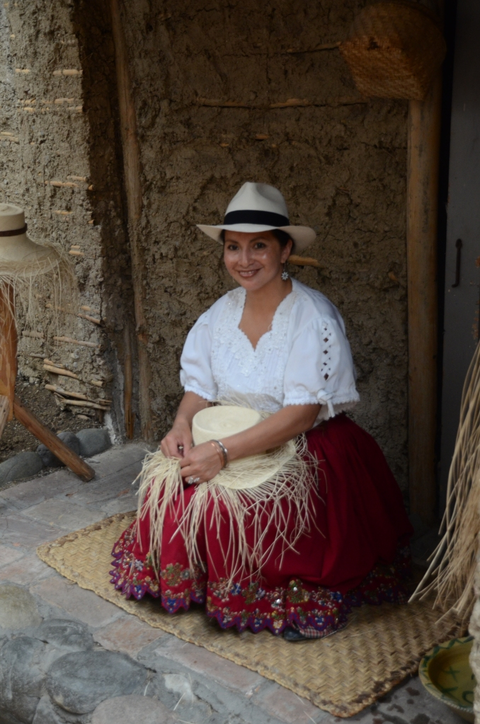 A lovely chola cuencana shows how hats are woven from straw.  In reality, the weaving is not done at the hat factory.  Women create the hats at home, then sell them to the factories for a small price.