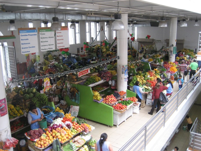 Fruits and vegetables for sale at the three level 9 de Octobre Market.