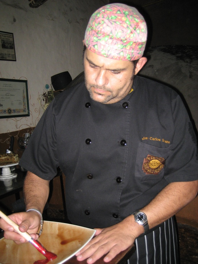 Chef Juan Carlos, of Tiesto's restaurant, hand painting a dessert treat.