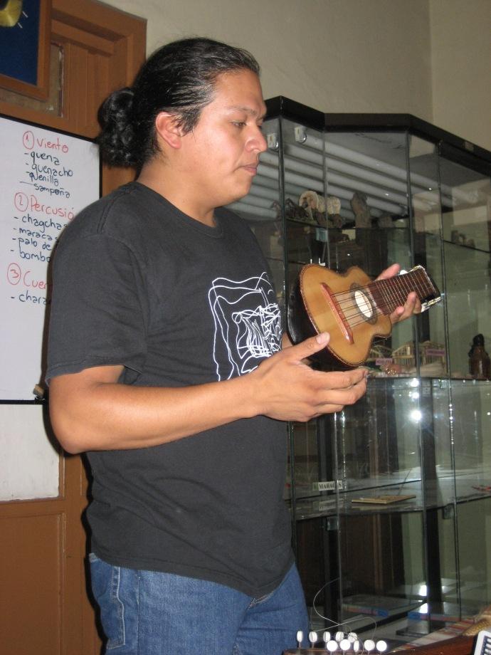 Carlos holds a charango