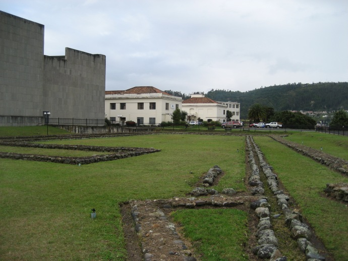 The site of the Palace, with a high school (white) and the Banco Central (gray) in the background.