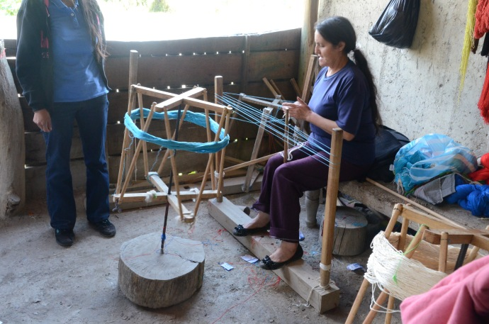 Using a handmade machine to make a skein of wool