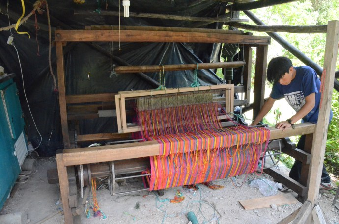 Large rug-making loom in an open-sided shed