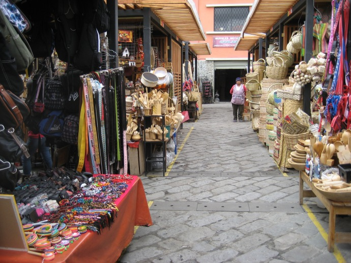Rows of vendor booths at the 9 de Octobre market
