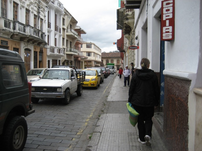 Cuenca has busy streets and narrow sidewalks (this was one of the wider ones)
