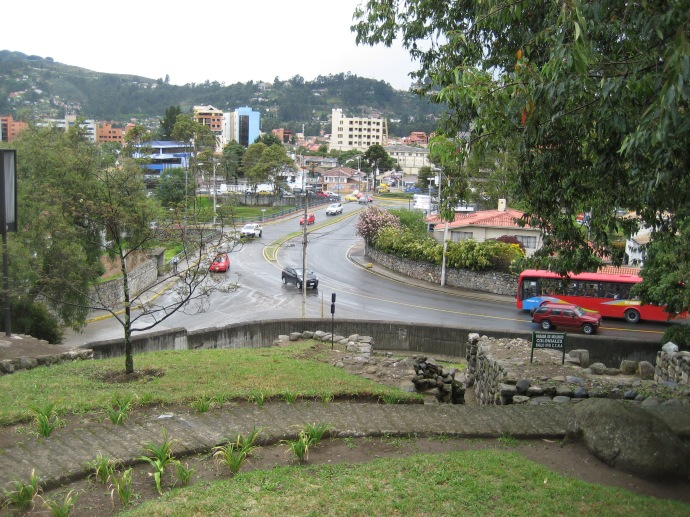 A small Inca or Canaris ruin, on the cliff side.  We are atop, in the old city looking toward the new part of Cuenca.  Yes, it is raining