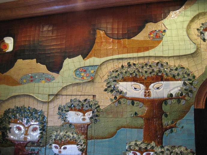 Vega mural behind the check-in desk at Hotel Crespo in Cuenca