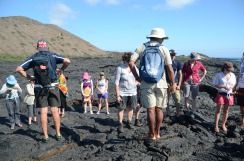 Our guide (with the white hat, blue backpack, and bare feet) discusses rope lava development with our gang from the ship.