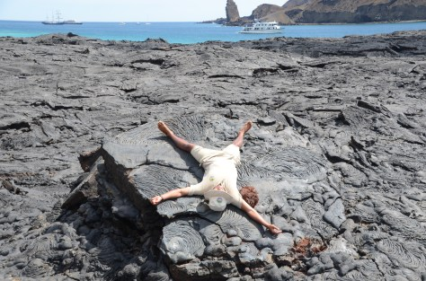 Our guide upside-down on the lava field. Our ship, the MV San Jose, in in the top center of the photo.