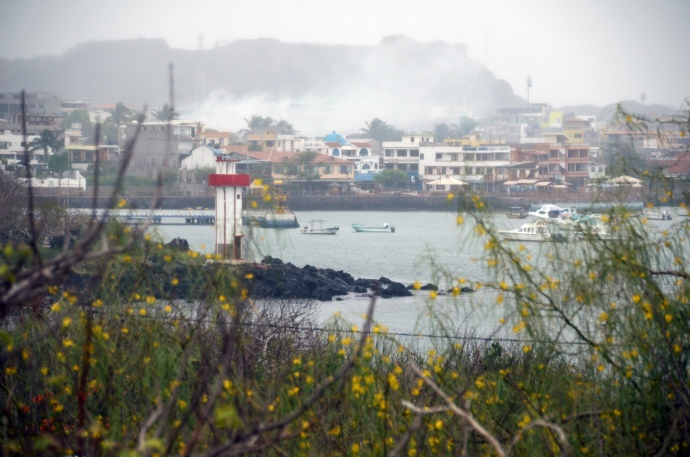 San Cristobal harbor, with mists around the mountain