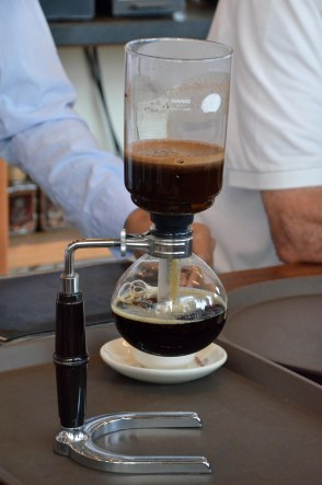 A siphon coffee maker, about halfway through the brewing process.
