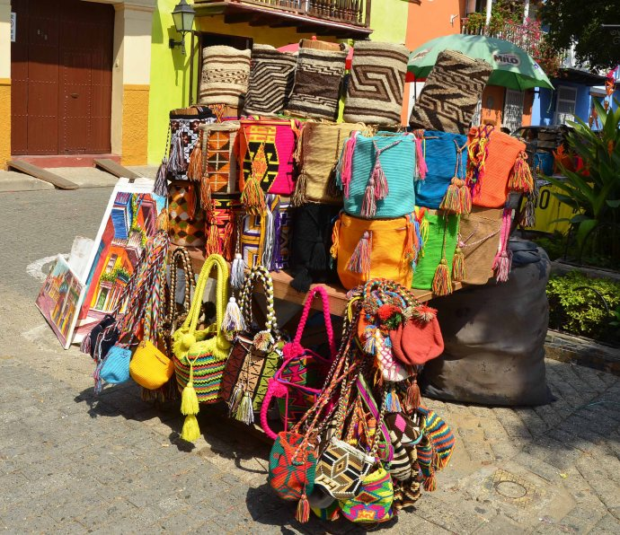 Bags woven from caña flecha braids. The ones in the top row are the more traditional colors